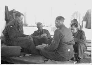 4. Laurie and the lads relaxing at Meherabad February 1943