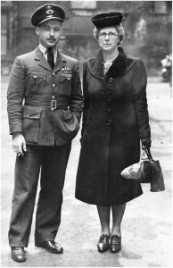 John with mother at Bucdkingham palace DFC