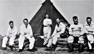 B' Flight pilots posing for this very casual photograph, they are from left to right FO Thom, PO Dowding, FL Treacy standing at the doorway of tent, FO Hoare, FSgt Maine and Sgt Bushell