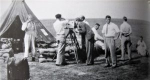 The camera crew prepare for another film shot at the opening of the 74 squadron Bell tent, known as 'The Tiger's Den'
