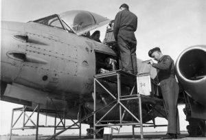 May 1951. Sqn Armament NCO Flt Sgt Blake checks the ammo